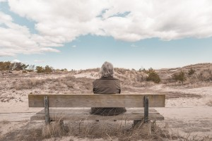 woman, older alone on bench