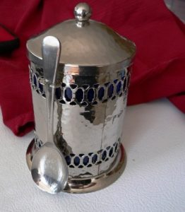 silver canister using cleaned spoon